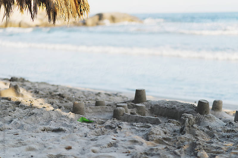 Sand castle on the beach by Luca Pierro for Stocksy United