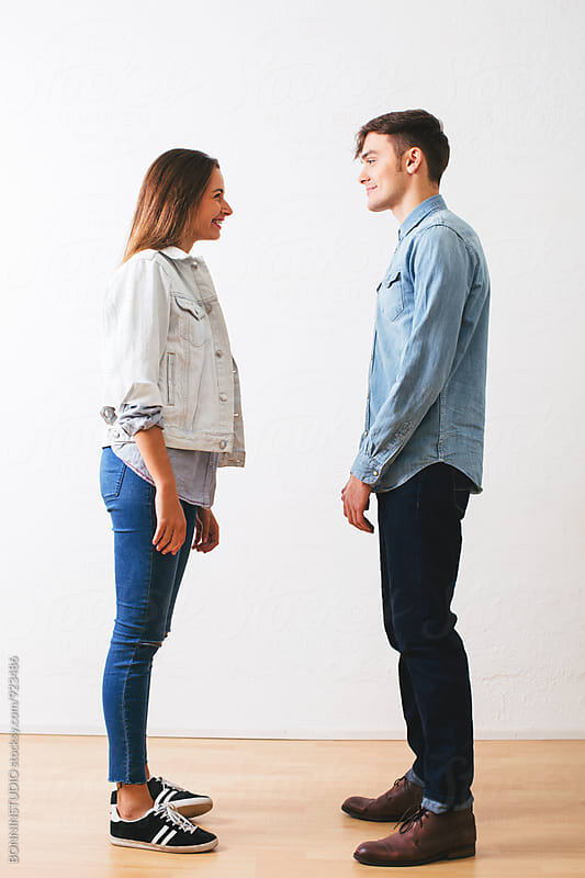 Side view of a couple wearing casual denim clothes. by BONNINSTUDIO for Stocksy United