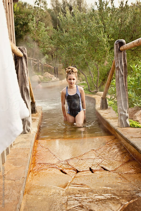 young girl at hot springs by Gillian Vann for Stocksy United
