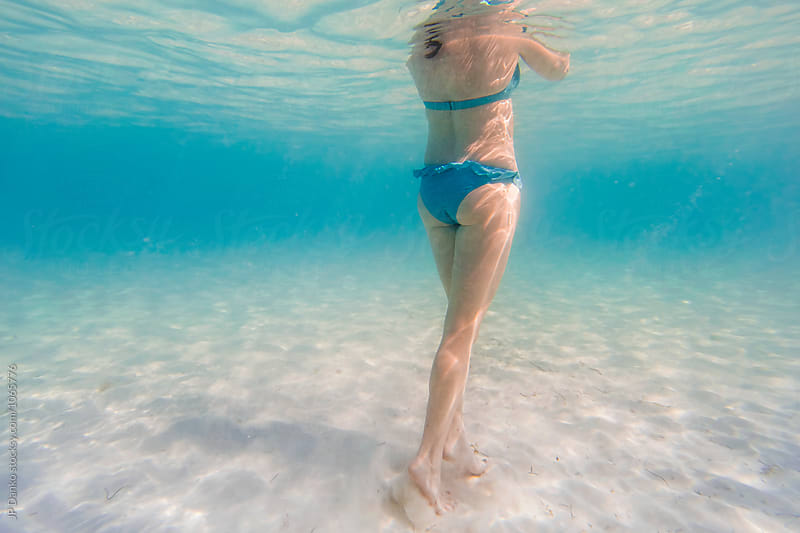 Underwater Woman In Bikini Walking on White Sand Beach at Luxury Caribbean Resort by JP Danko for Stocksy United