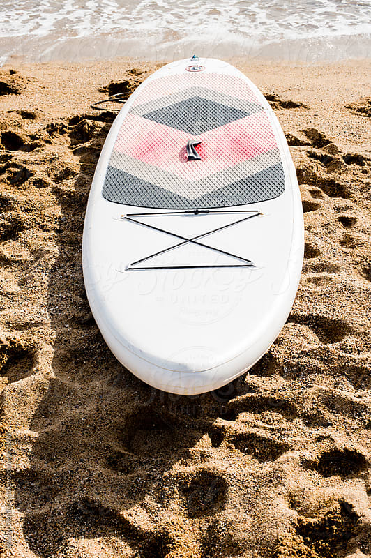 Paddle board on the beach, Barcelona  by Bisual Studio for Stocksy United