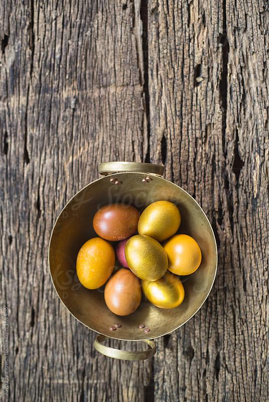 Golden Easter eggs in golden basket by Jovo Jovanovic for Stocksy United