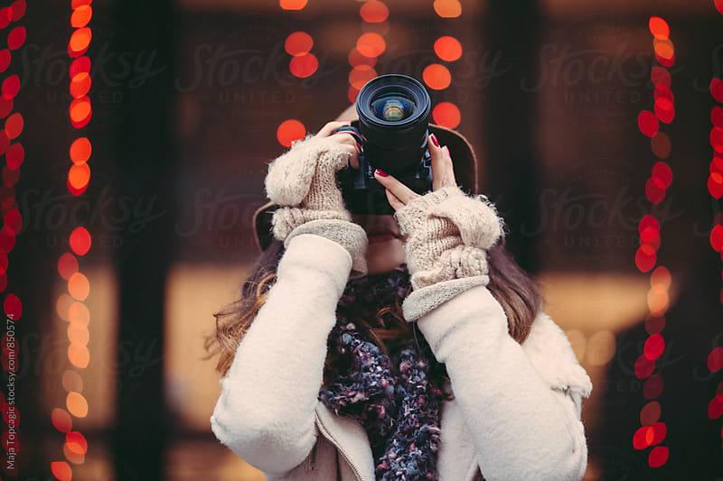 Photographer taking photos outdoors by Maja Topcagic for Stocksy United