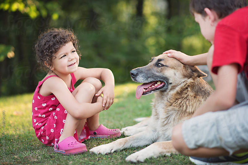 Children and their dog by Lea Csontos for Stocksy United