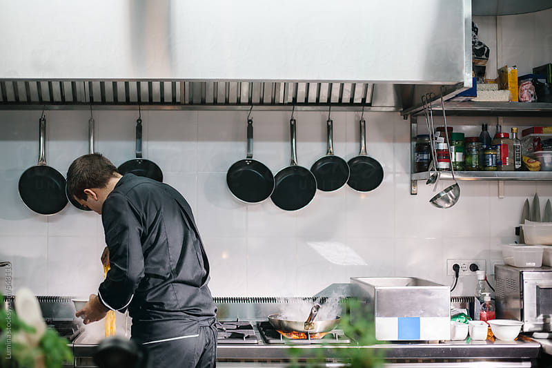 Chef Preparing Food in a Commercial Kitchen by Lumina for Stocksy United