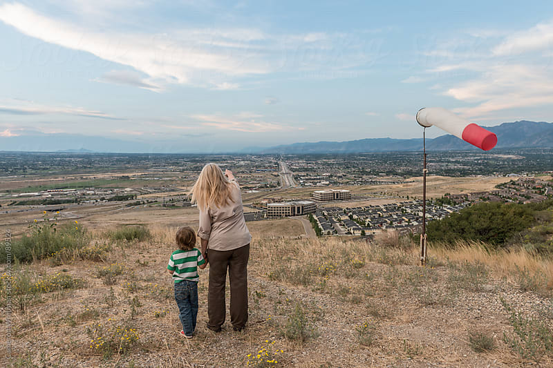 Grandmother Pointing Out Her Home From High Above The Valley by Cameron Whitman for Stocksy United