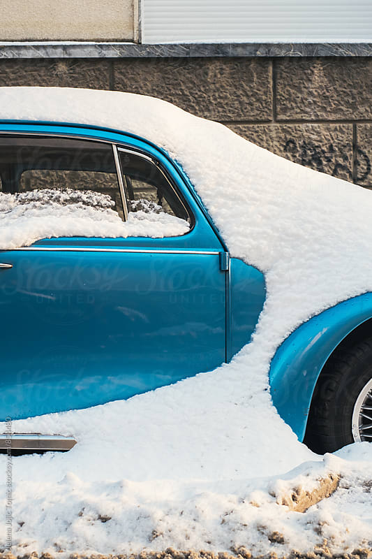 Car after snowfall by Jelena Jojic Tomic for Stocksy United