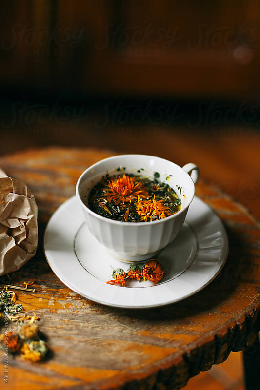 Mixed herbs tea in a white cup by Marija Kovac for Stocksy United