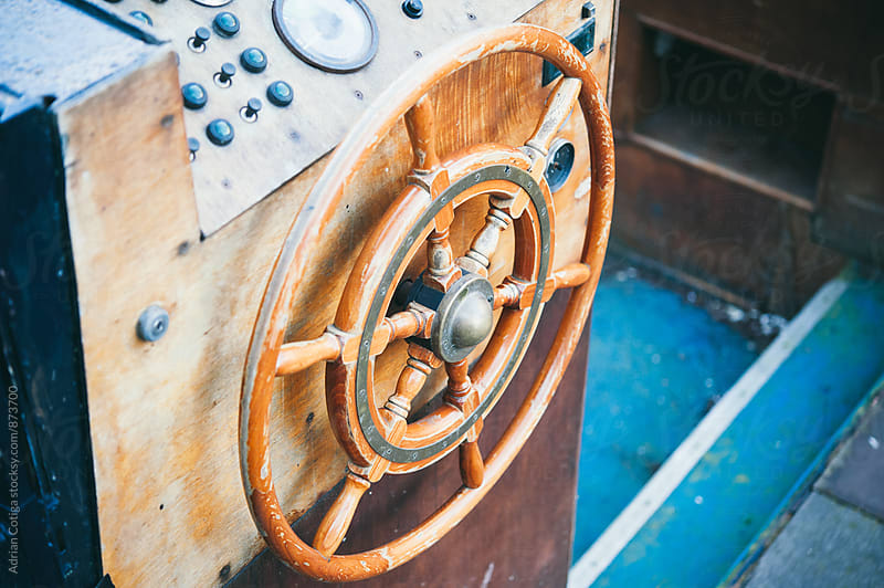 Helm (steering wheel) of a sailing ship by Adrian Cotiga for Stocksy United