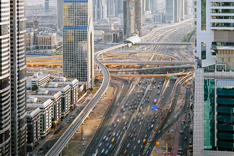 Elevated view of traffic along Sheikh Zayed Road, Dubai, United Arab Emirates by Gavin Hellier for Stocksy United