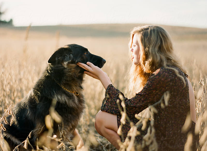 A girl and her dog by Marta Locklear for Stocksy United