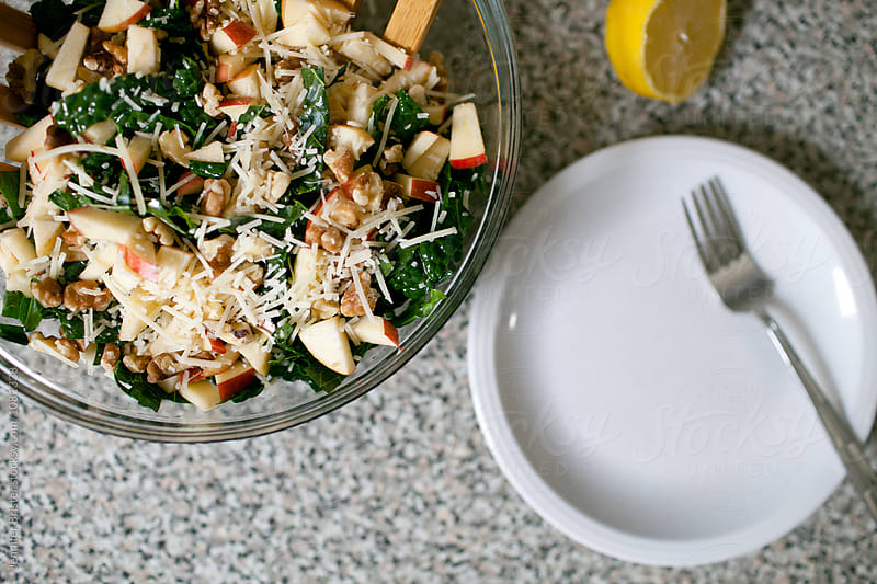 prepared kale salad with salad plate  by Jen Brister for Stocksy United