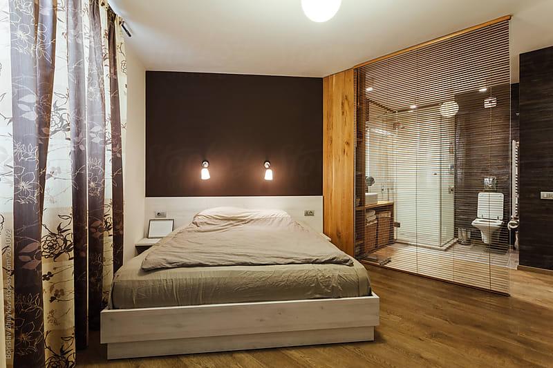 Modern Bedroom Interior with Bathroom by Borislav Zhuykov for Stocksy United