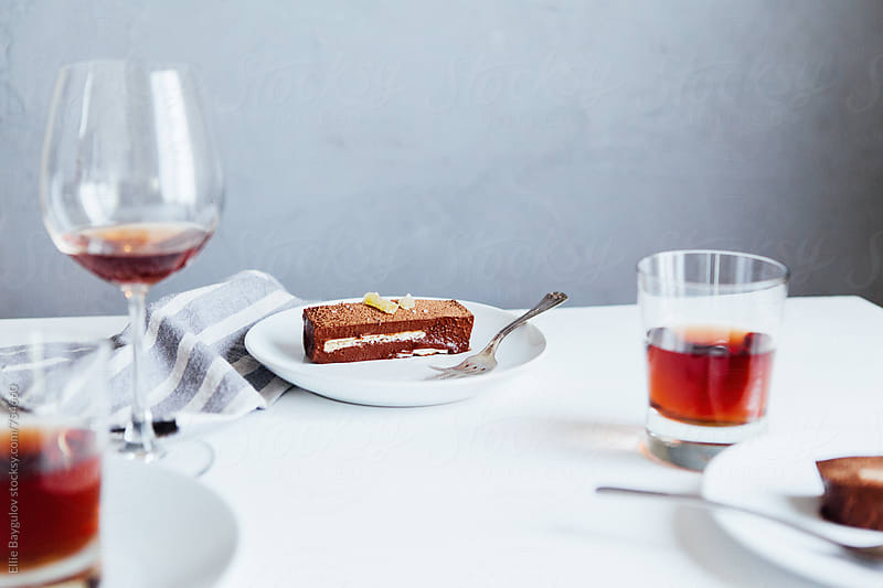 Chocolate mouse slice with citrus biscuit by Ellie Baygulov for Stocksy United