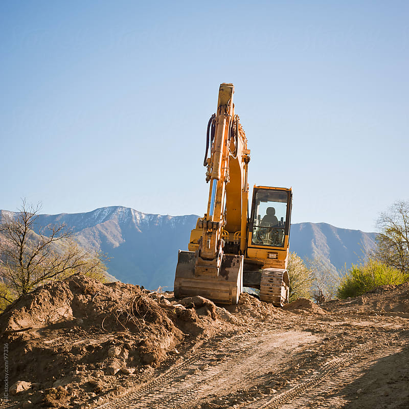 Excavator In A Construction Site by GIC for Stocksy United