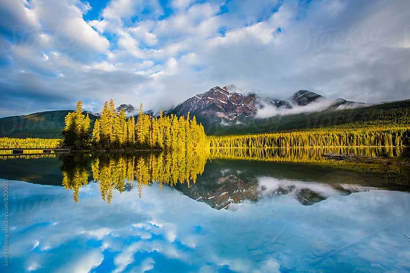 mountains and pine trees with reflection by Song Heming for Stocksy United