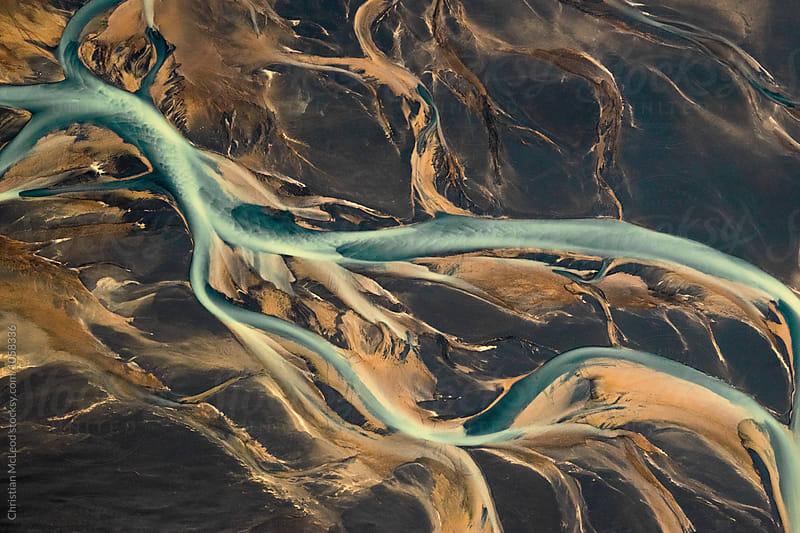 Icelandic glacial river flow by Christian McLeod Photography for Stocksy United