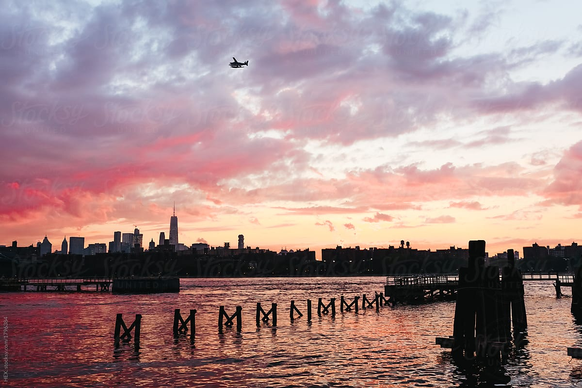 seaplane over manhattan skyline at the sunset new yotk city