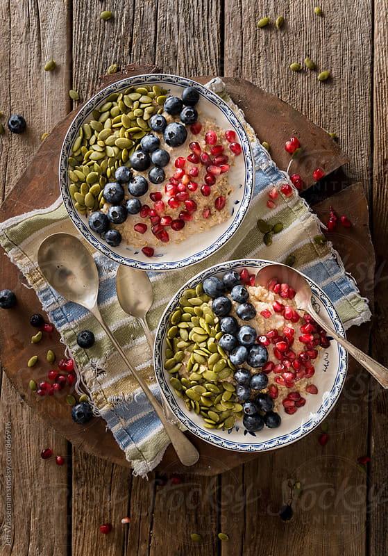 Healthy Oatmeal with Fruit and nuts by Jeff Wasserman for Stocksy United