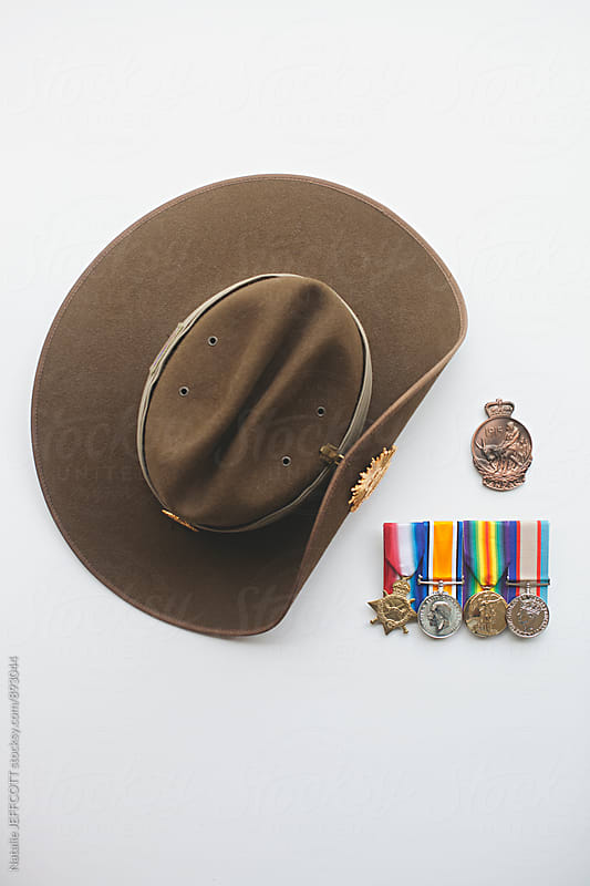 An Australian army khaki slouch hat with collection of service medals and medallions by Natalie JEFFCOTT for Stocksy United