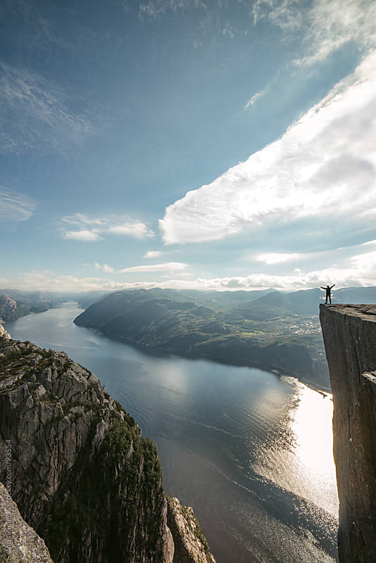 Person standing at the edge of a cliff by Chris Zielecki for Stocksy United