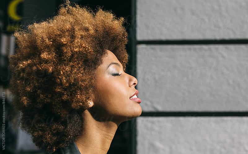 Profile Headshot Portrait of an Afro Young Woman by VICTOR TORRES for Stocksy United