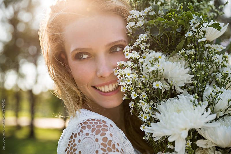 Portrait a beautiful woman with white flowers by Jovo Jovanovic for Stocksy United