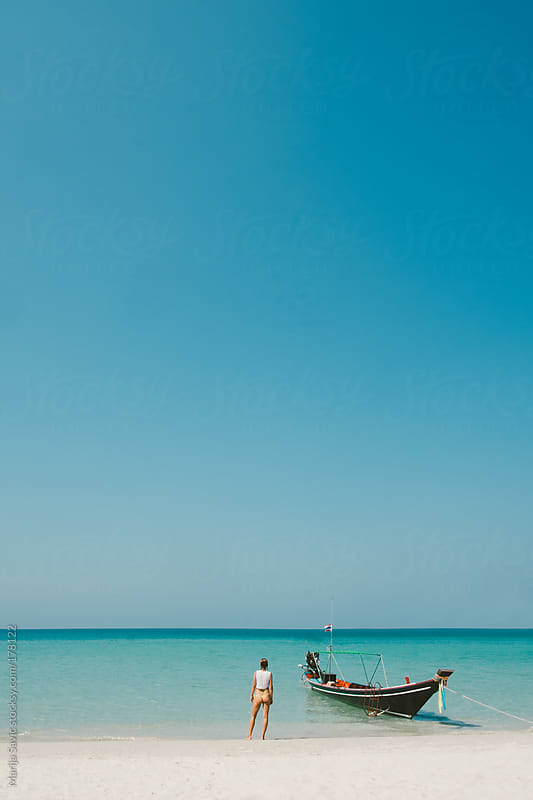 Woman Standing and Looking at the Ocean by Marija Savic for Stocksy United