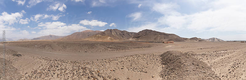 Panorama of desert valley and mountains in Nazca Peru by Ben Ryan for Stocksy United