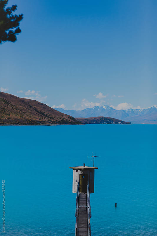 A water tank in a lake by Leandro Crespi for Stocksy United