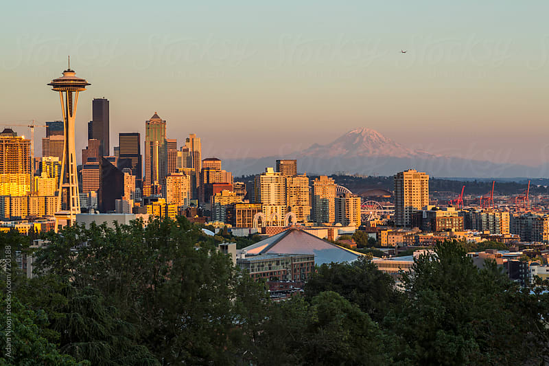 Seattle skyline and Mount Rainier by Adam Nixon for Stocksy United