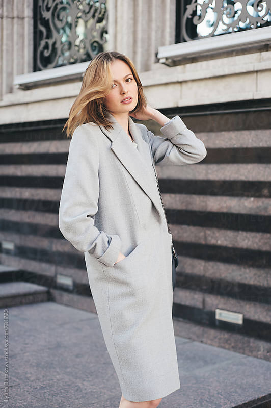 Beautiful woman wearing grey coat by Lyuba Burakova for Stocksy United