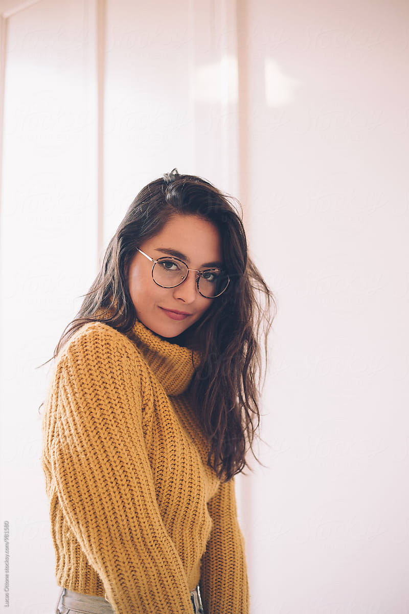 410f088db4 Young Brunette Woman With Round Glasses