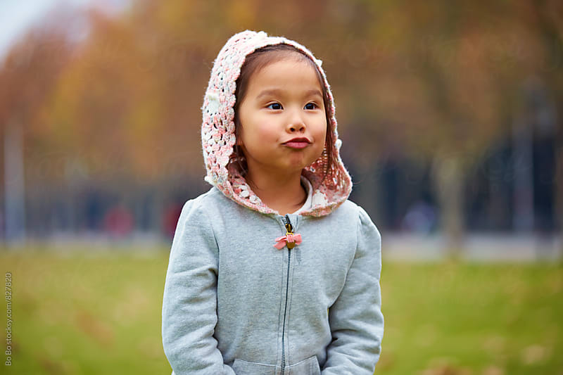 lovely little asian little girl playing outdoor by Bo Bo for Stocksy United