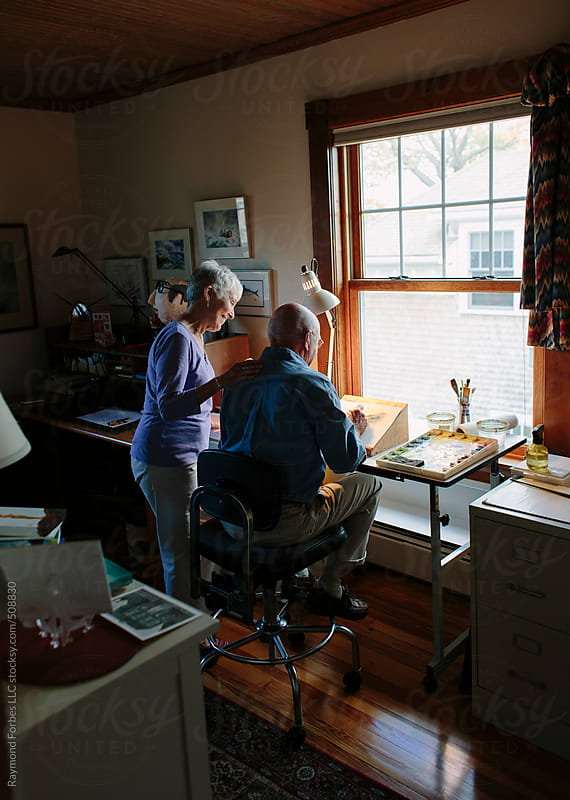 Senior Lifestyle image of Watercolor artist in his studio by Raymond Forbes LLC for Stocksy United