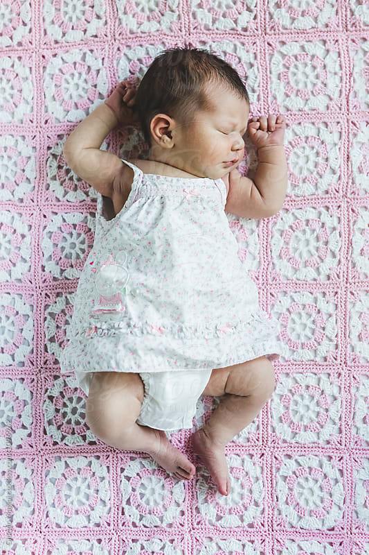 Newborn Baby Girl Sleeping on an Handmade Blanket by Giorgio Magini for Stocksy United