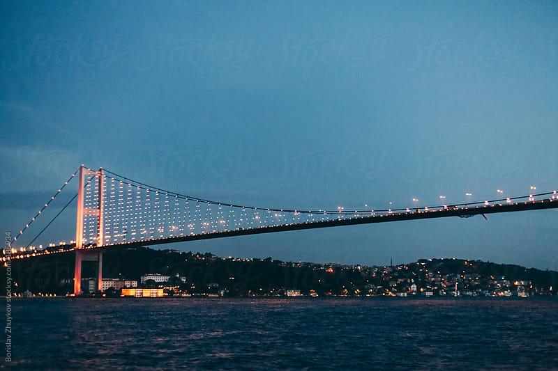 Bosphorus Bridge by night by Borislav Zhuykov for Stocksy United