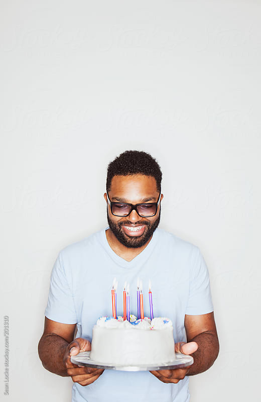 Portraits: Man Excited with Birthday Cake by Sean Locke for Stocksy United