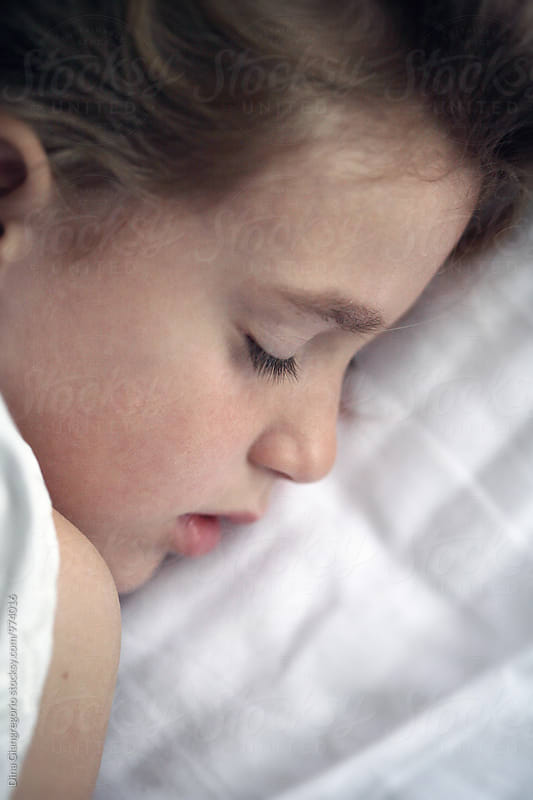 Profile View Of Little Girl Sleeping by Dina Giangregorio for Stocksy United