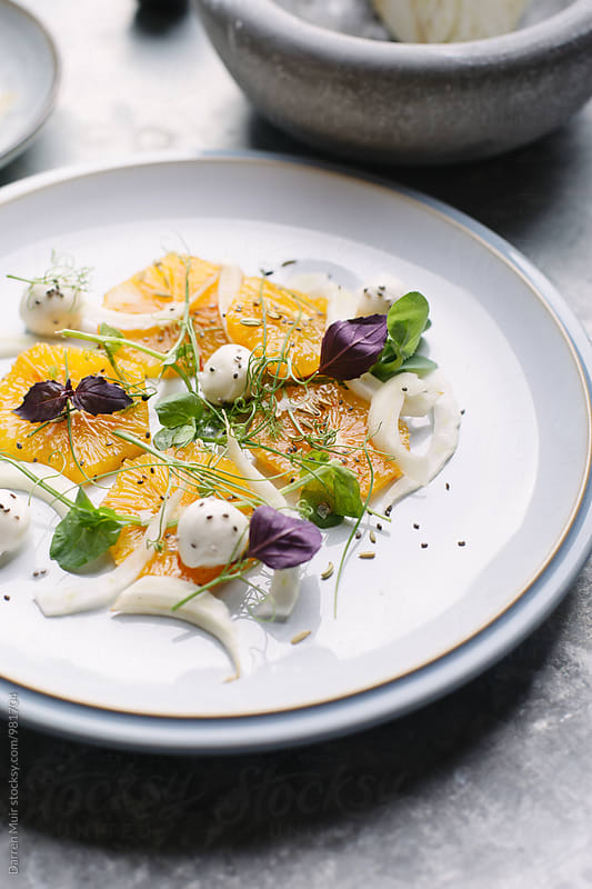 Fennel and orange salad,with micro herbs. by Darren Muir for Stocksy United