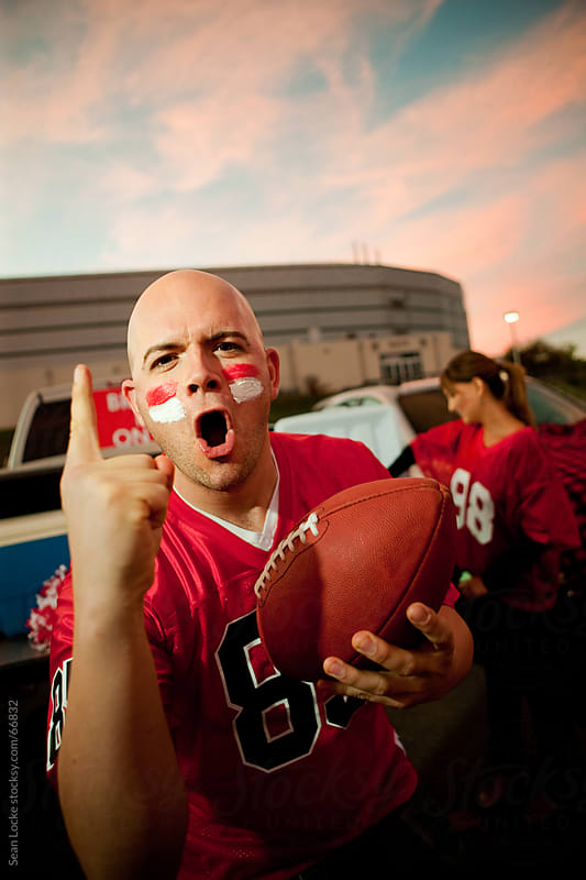 Tailgating: Excited Fan Cheers for Team by Sean Locke for Stocksy United