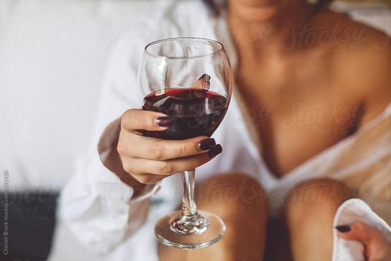Sipping Red Wine. by Cherish Bryck for Stocksy United
