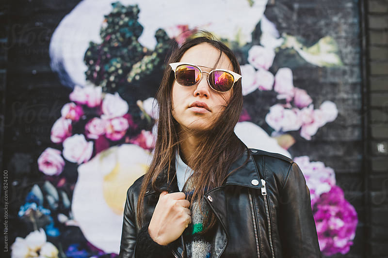 Young woman with cool sunglasses by Lauren Naefe for Stocksy United