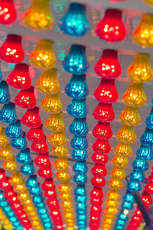 Fairground lights under a canopy by Paul Phillips for Stocksy United