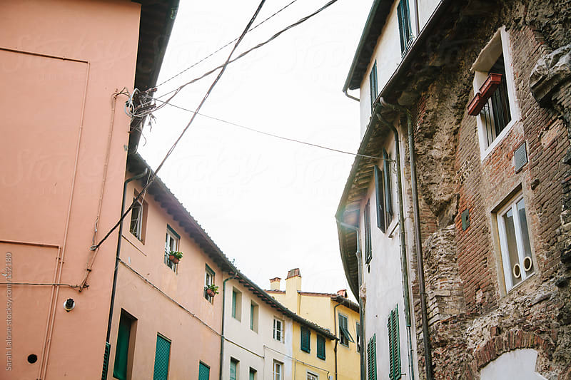 rooftops in lucca, tuscany, italy on a cloudy day by Sarah Lalone for Stocksy United