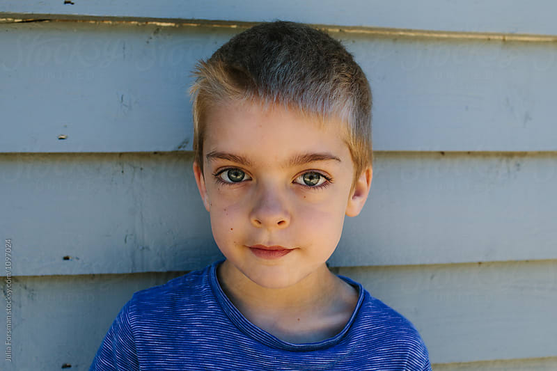 Portrait of young boy with short blonde hair. by Julia Forsman for Stocksy United