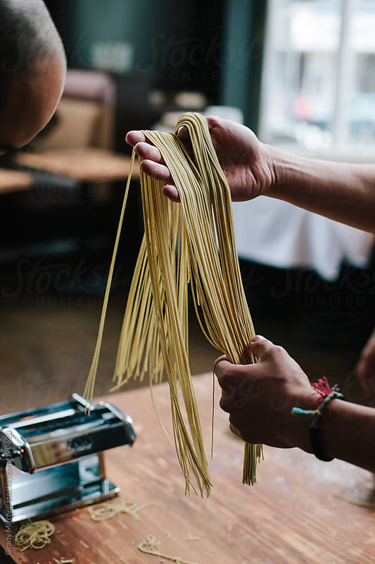 Chef's Hands Holding Handmade Pasta by Grady Mitchell for Stocksy United