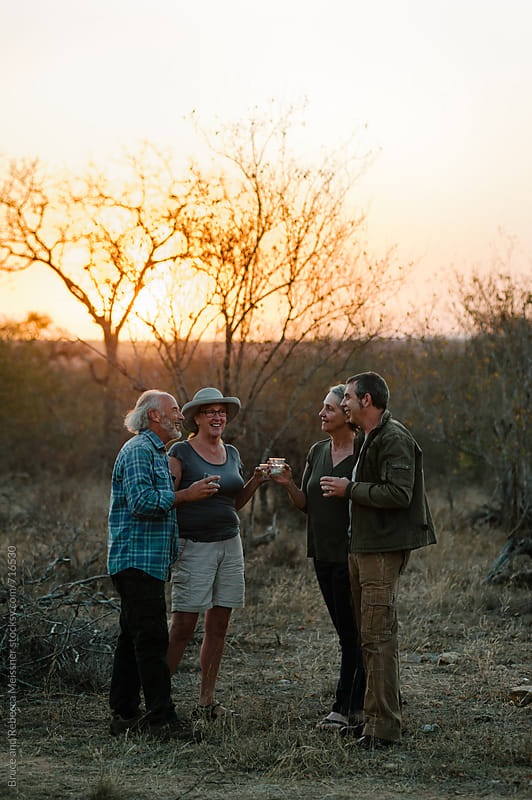 Friends having sundowners by Bruce and Rebecca Meissner for Stocksy United