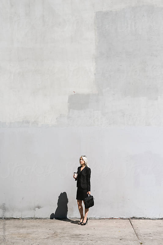 Cool businesswoman against a big wall by WAVE for Stocksy United