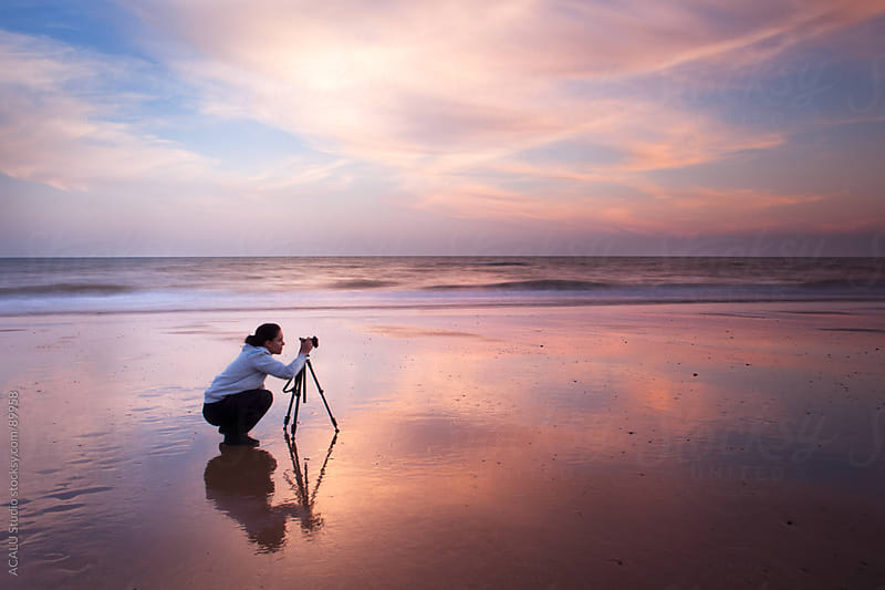 Photographer with tripod shooting a landscape in Doñana by ACALU Studio for Stocksy United